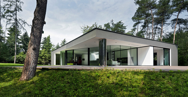 Photo of modern minimalist home with the forest in the background