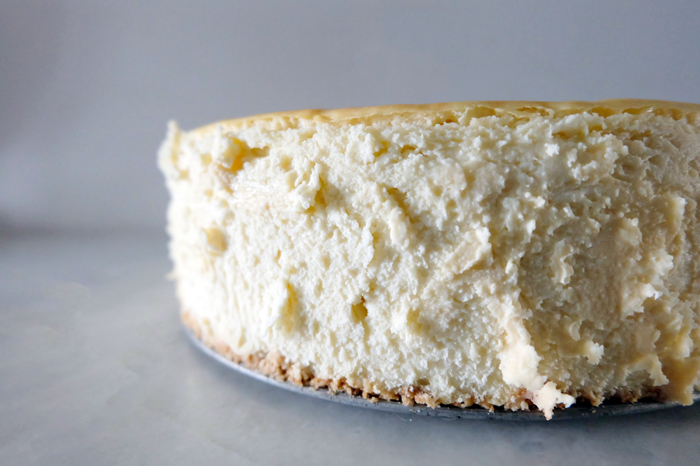 side view of cheesecake removed from springform pan