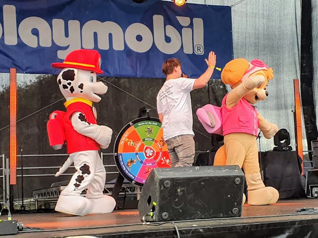 Image of the main stage at Gloworm Children's Festival 2021 featuring Skye and Marshall from Paw Patrol, alongside a presenter/host