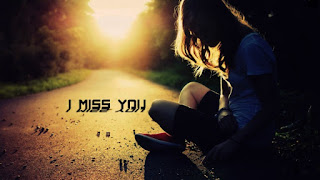 cute & beautiful sad girl sitting on the road with i miss you