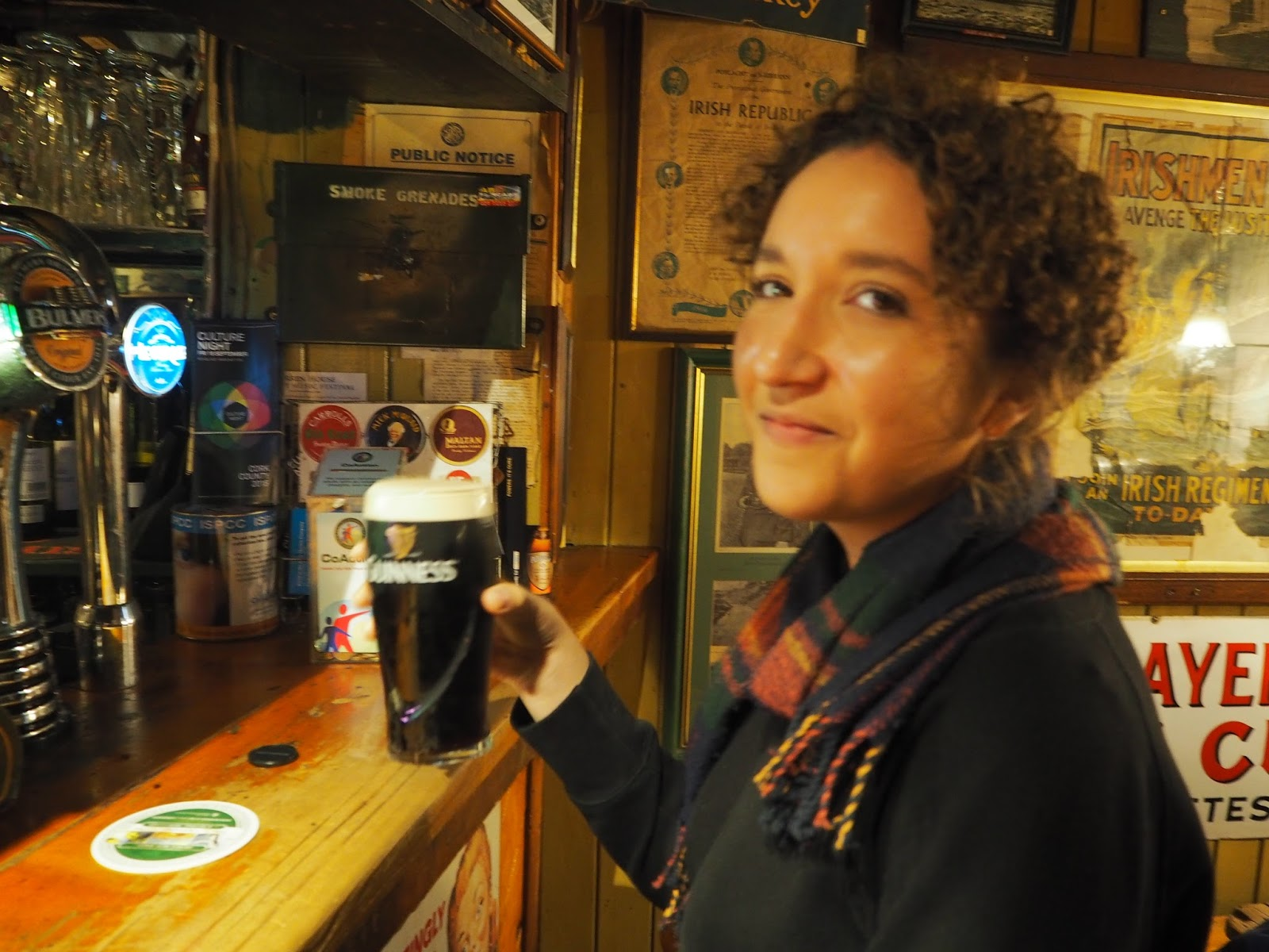 drinking guinness in irish pub