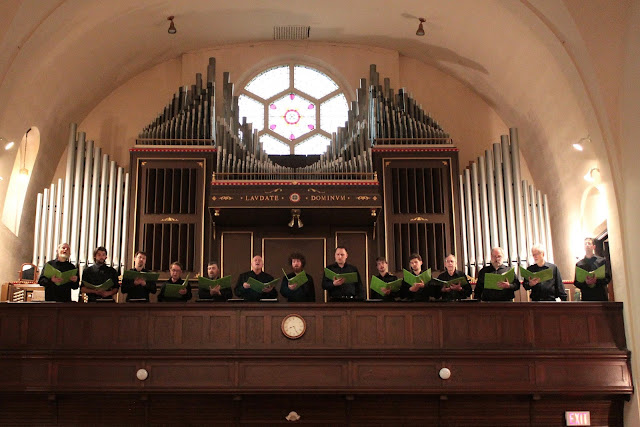The Men of the Stairwell Carollers sing from the choir loft at St. Barnabas church, Ottawa