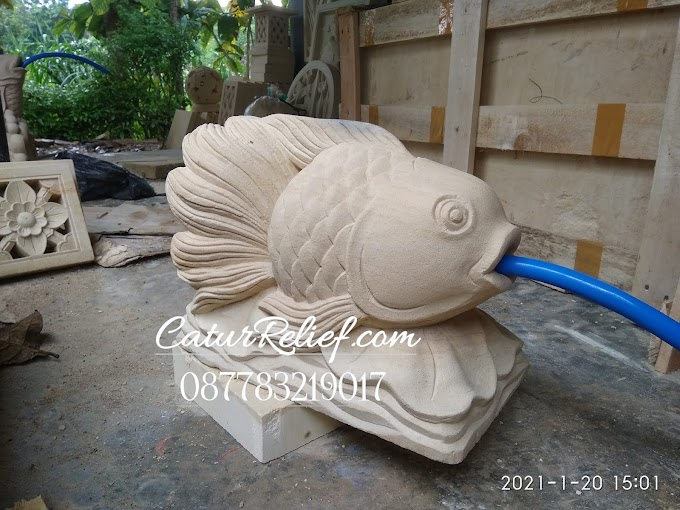 Patung ikan air mancur pahatan dari batu paras jogja