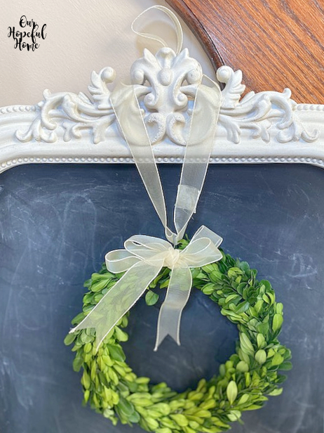 green boxwood wreath yellow ribbon chalkboard