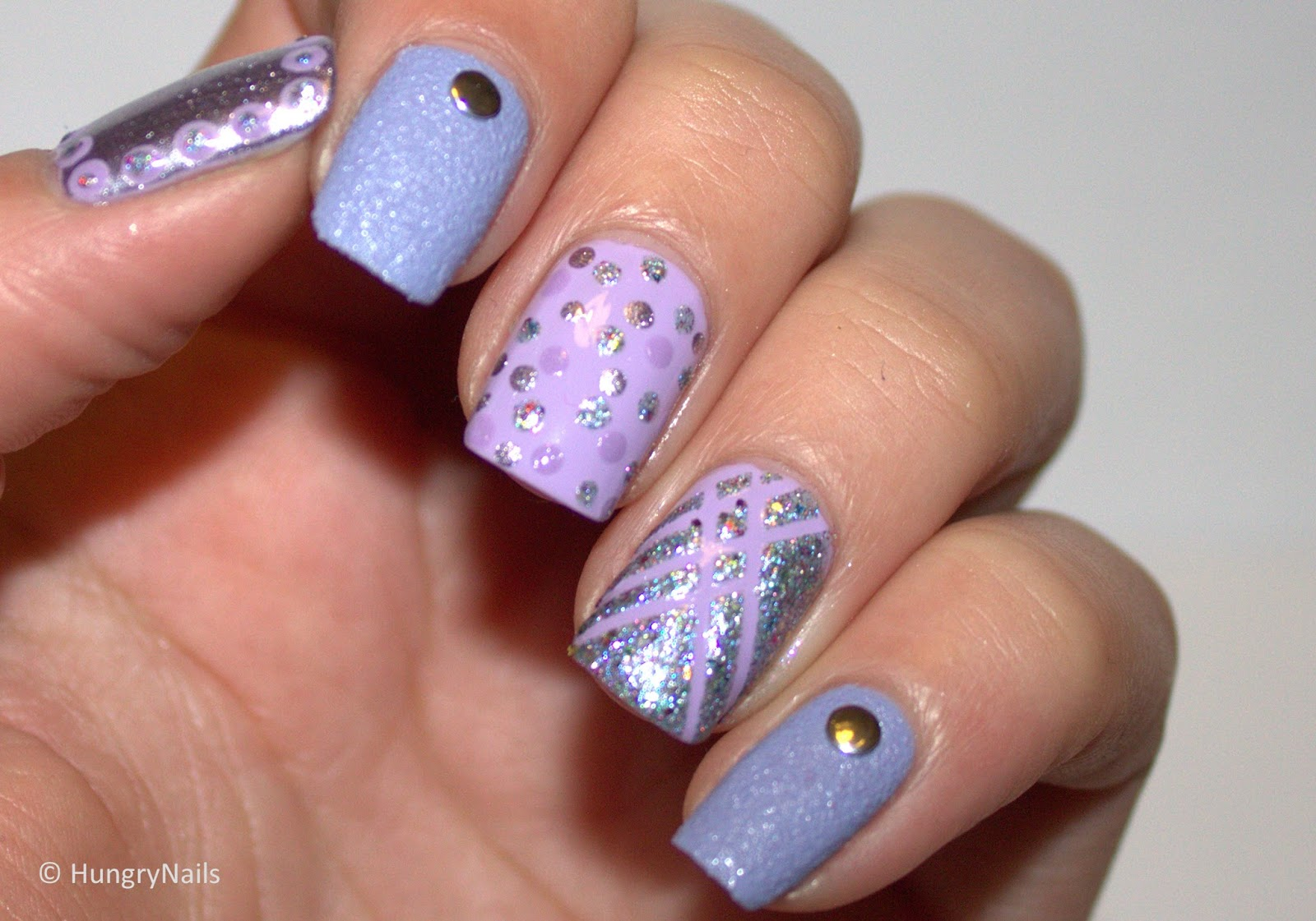 http://hungrynails.blogspot.de/2014/02/skittle-nails-in-flieder.html