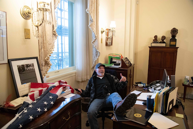 Man with foot up on desk in Pelosi's office at Capitol arrested