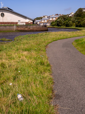 Photo of litter by the path along the River Ellen in Maryport
