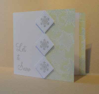 Christmas card with green and blue snowflake pattern on right and Let it Snow sentiment