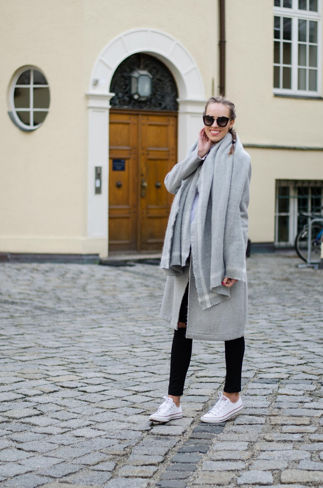 kristjaana gray coat white converse sneakers minimalist casual outfit french braids