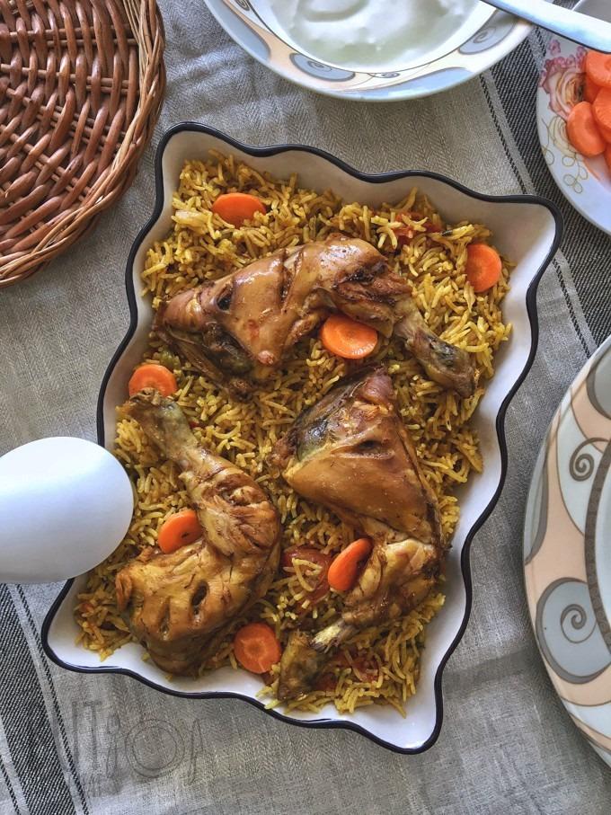Chicken machboos served in a casserole dish