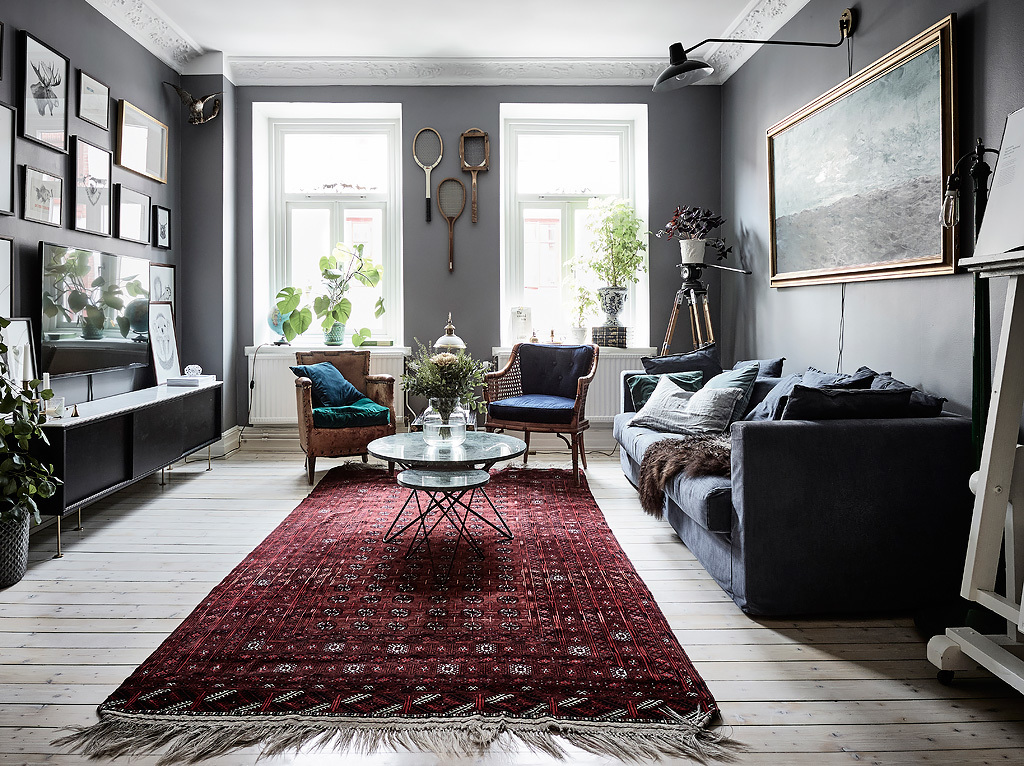 bohemian artist home scandinavian apartment  with houseplants wall art fireplace blue walls