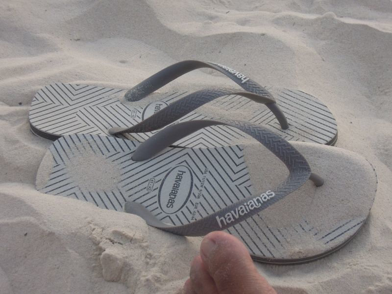 Slippers on white sand in Boracay