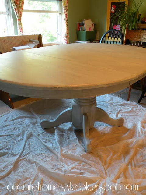 Dining table with first coat of paint