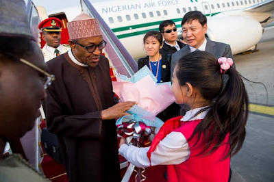 Pics: Buhari arrives China