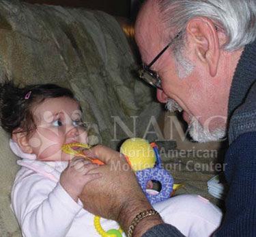 NAMC montessori explained importance of eye contact prepared environment grandpa looks at toddler