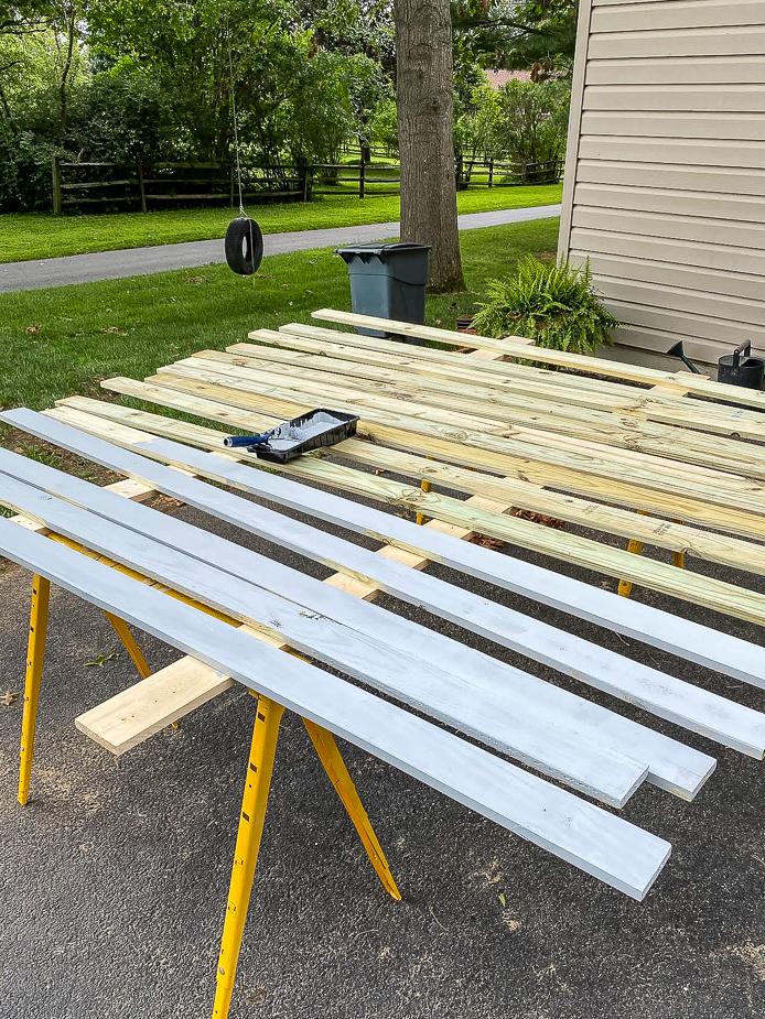 Priming pressure treated boards