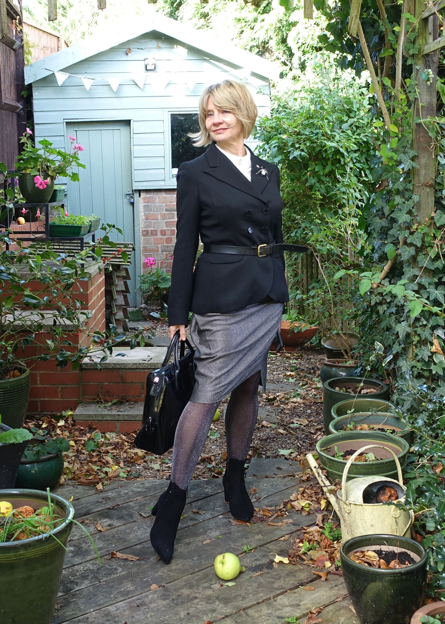 Is This Mutton's Gail Hanlon in office chic: what she used to wear to meet the ad agency. Max Mara jacket, Vivienne Westward skirt, black boots and cream pearl collar top