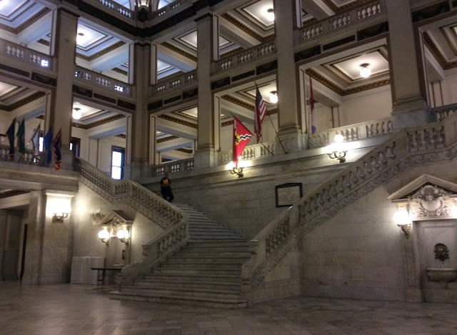 saint louis city hall marble staircase with flags