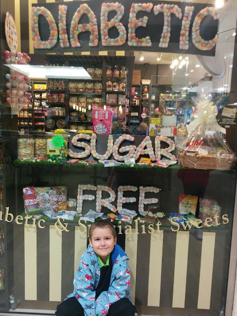Big Boy posing beneath a Diabetic Sugar Free Sweet Sign