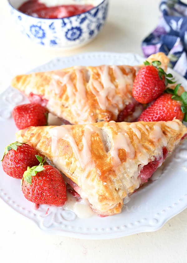 strawberry cream cheese turnovers on a plate