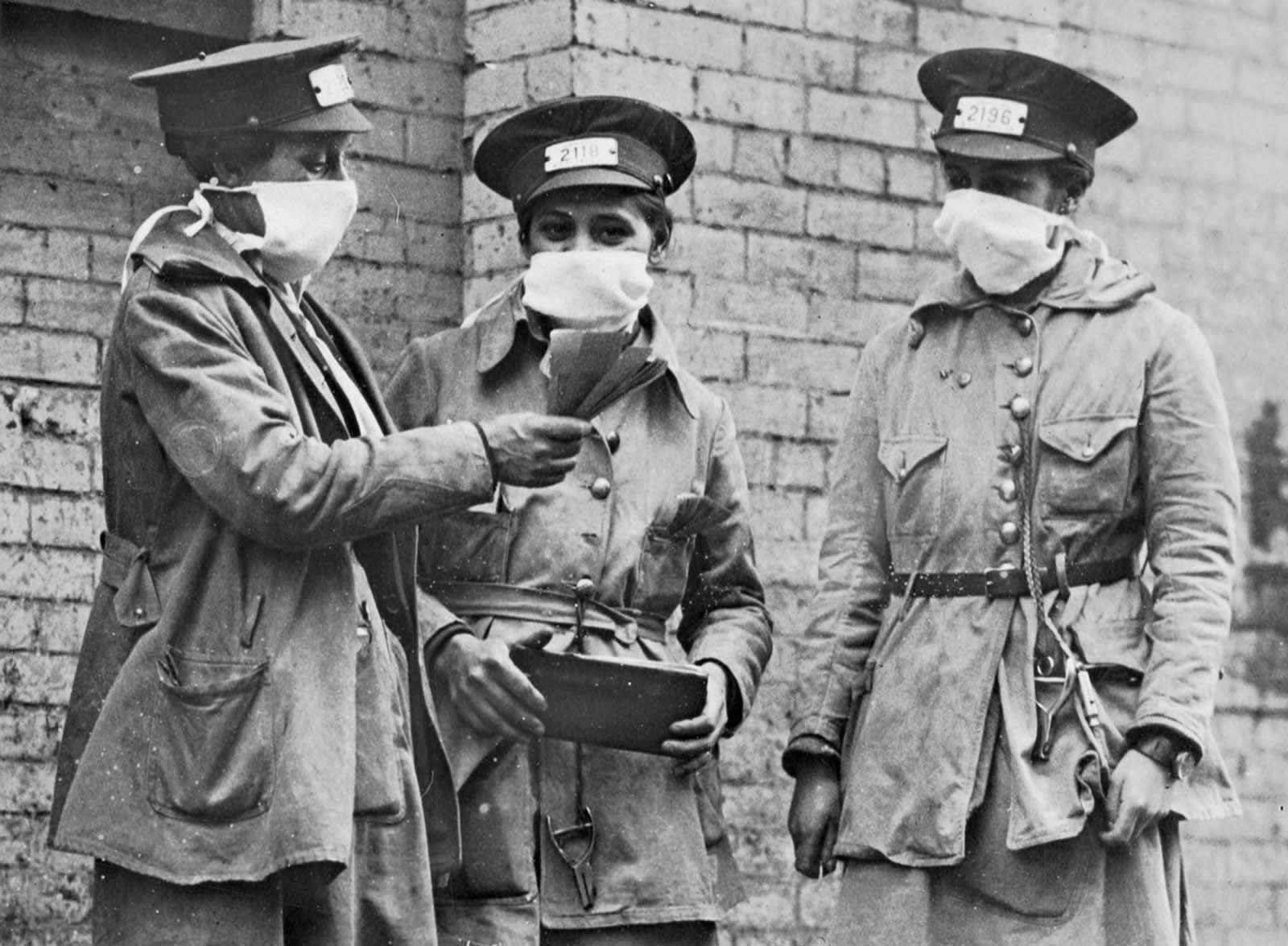 New York City conductorettes wear masks, on October 16, 1918.