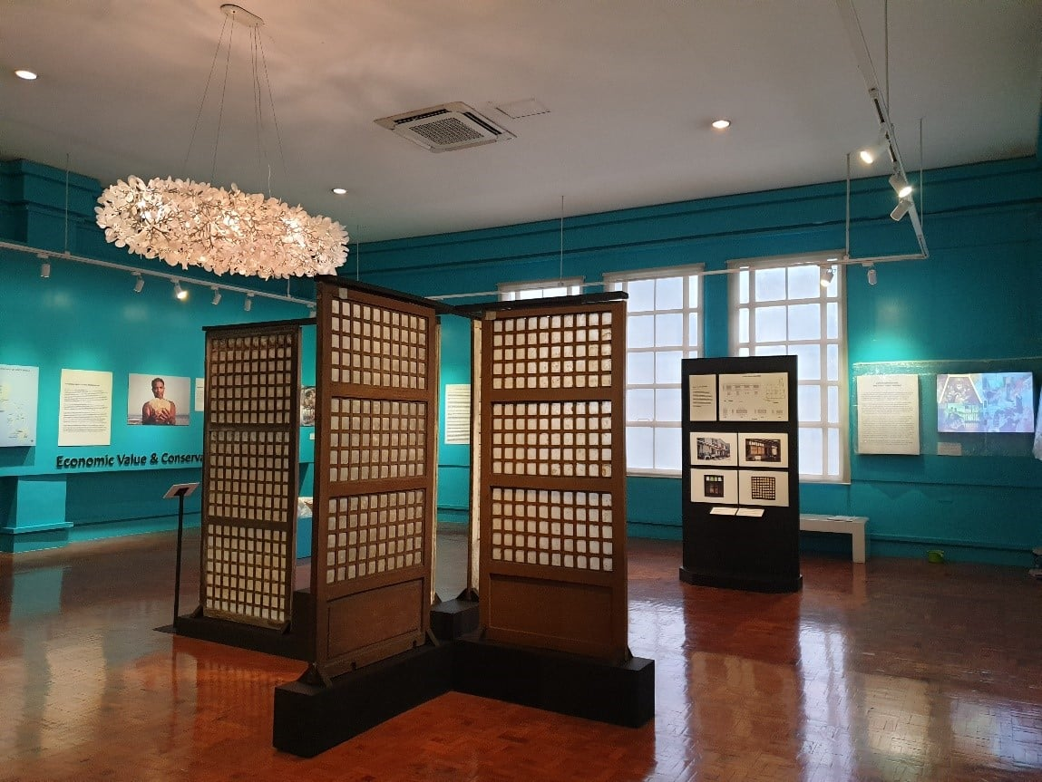 Exhibit photograph of the Placuna placenta: Capis Shells and Windows to Indigenous Artistry – panels on loan from PNU in the foreground