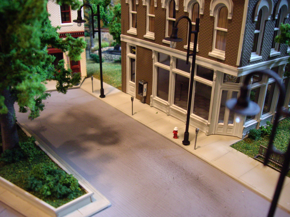 A sidewalk scene with details from a Walther's City Accessories kit including fire hydrants, parking meters and a phone booth