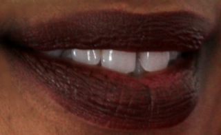 a woman wearing brown lipstick