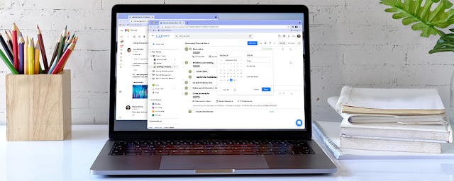 Laptop displaying GQueues and Gmail