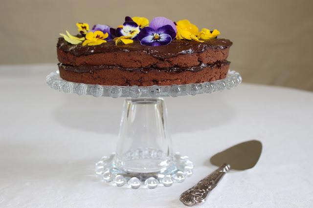 fudgey sweet potato chocolate cake with creamy avocado frosting