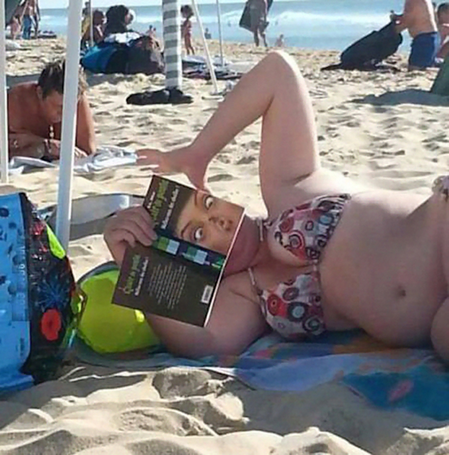 17 Hilarious Pictures Of People Reading All The Wrong Books In Public - I Love The Face You're Making… Oh Wait, That's Your Book