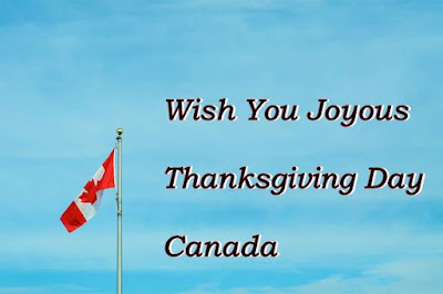 Wish you joyous Thanksgiving Day Canada text with blue sky & Canada flag.