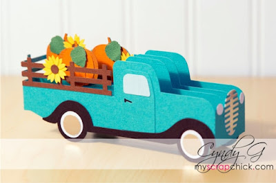 3d card in the shape of a vintage truck with pumpkins in the back