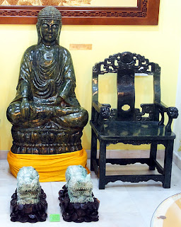 antique sitting buddha and jade chair