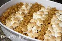 A shortcut sweet potato casserole with the unusual addition of banana and finished with rows of marshmallows and brown sugar sweetened cornflake cereal crumbs.