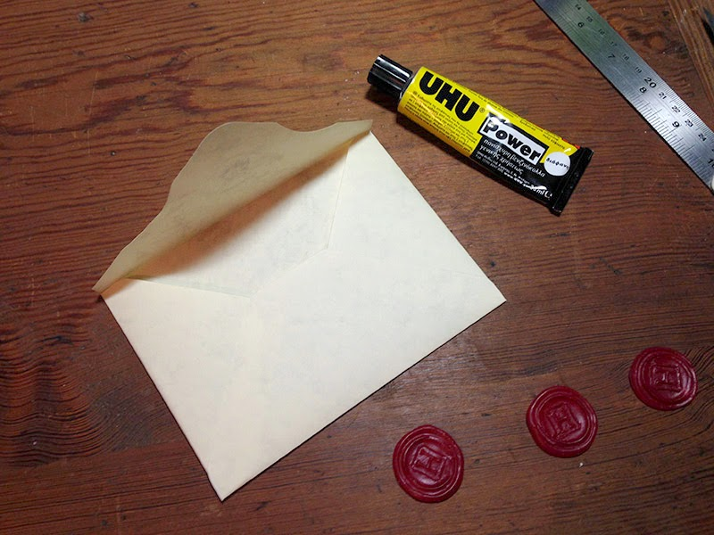 Bit of glue to attach the dried glue to the glued envelope