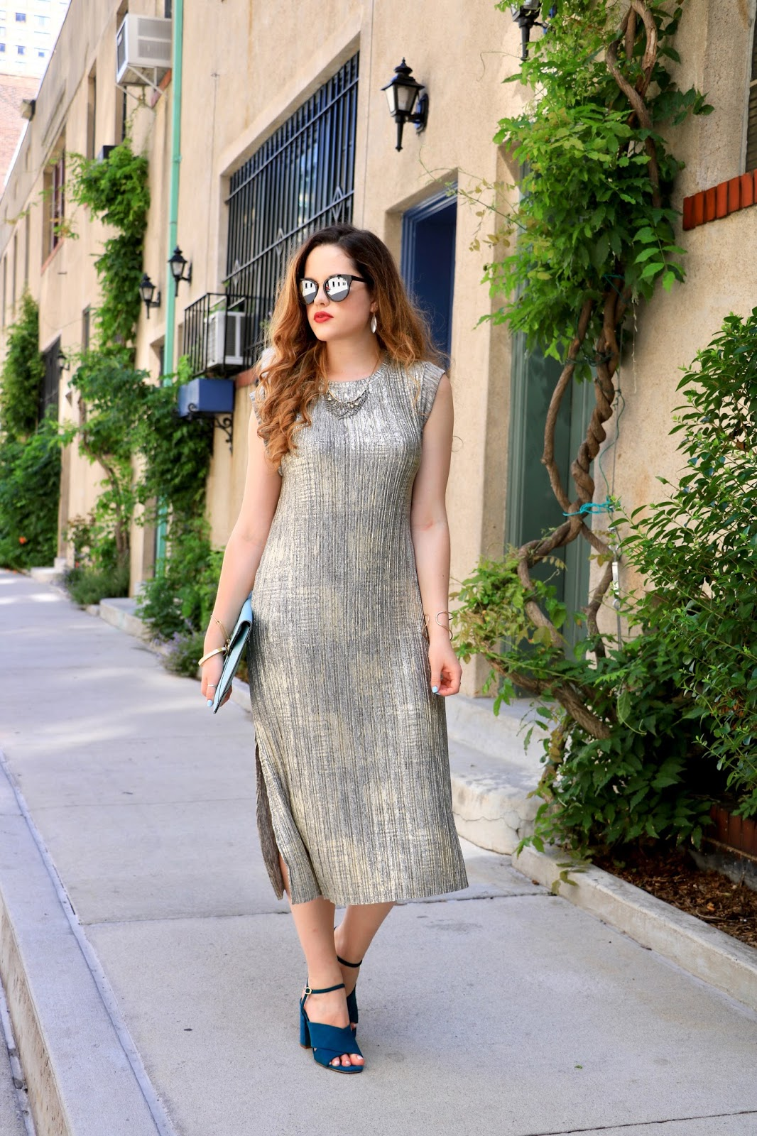 NYC fashion blogger showing how to wear a gold dress