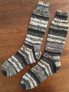 Socks are knitted with wedge toes and traditional heel flap
