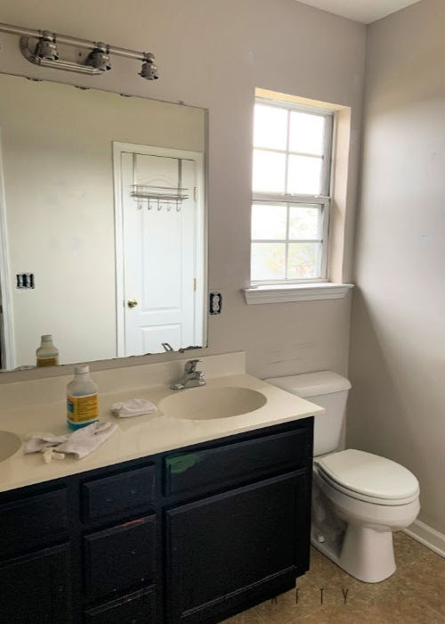 Bathroom Makeover on a budget  |  before makeover, paint over black cabinets, paint walls, take down large mirror glued to wall
