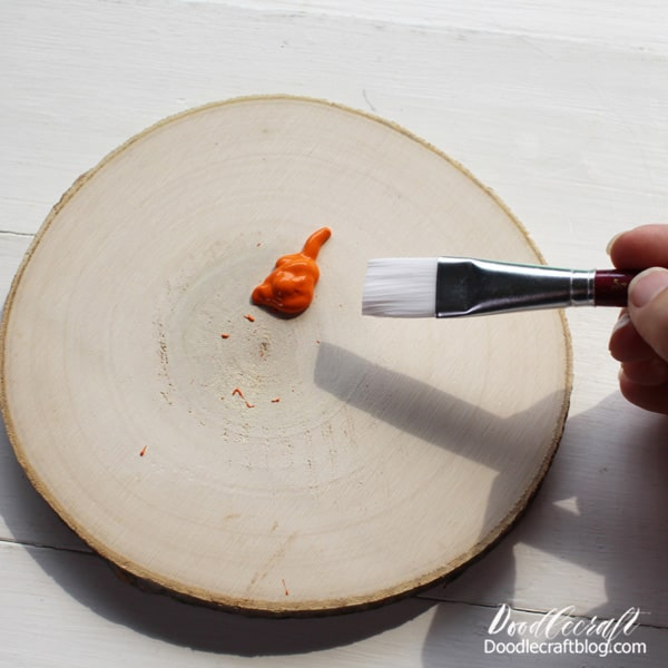 Wood Slice Pumpkin Step 1: Paint Begin by painting the top of the wood slice with orange craft paint. Then let the paint dry completely.