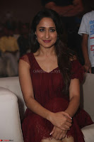 Pragya Jaiswal in Stunnign Deep neck Designer Maroon Dress at Nakshatram music launch ~ CelebesNext Celebrities Galleries 122.JPG