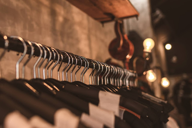 clothes hanging on coat hangers:Photo by Artem Beliaikin from Pexels