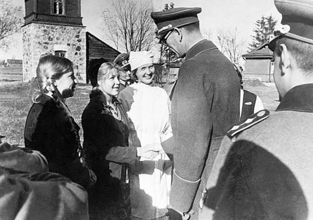 Former Soviet Lt. General Andrey Andreyevich Vlasov greets some admirers worldwartwo.filminspector.com