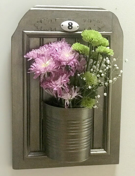 Fresh flowers in a recycled aluminum can planter