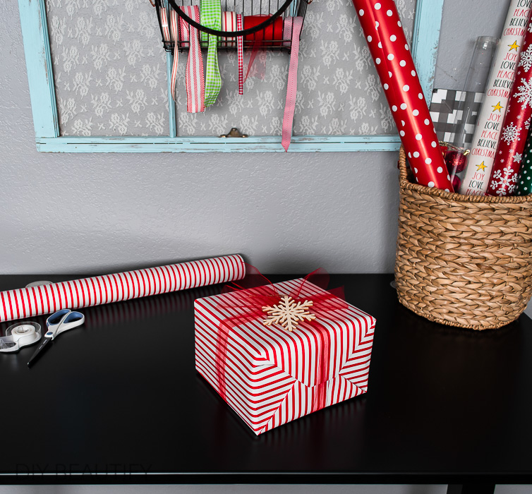 red striped gift with wood snowflake