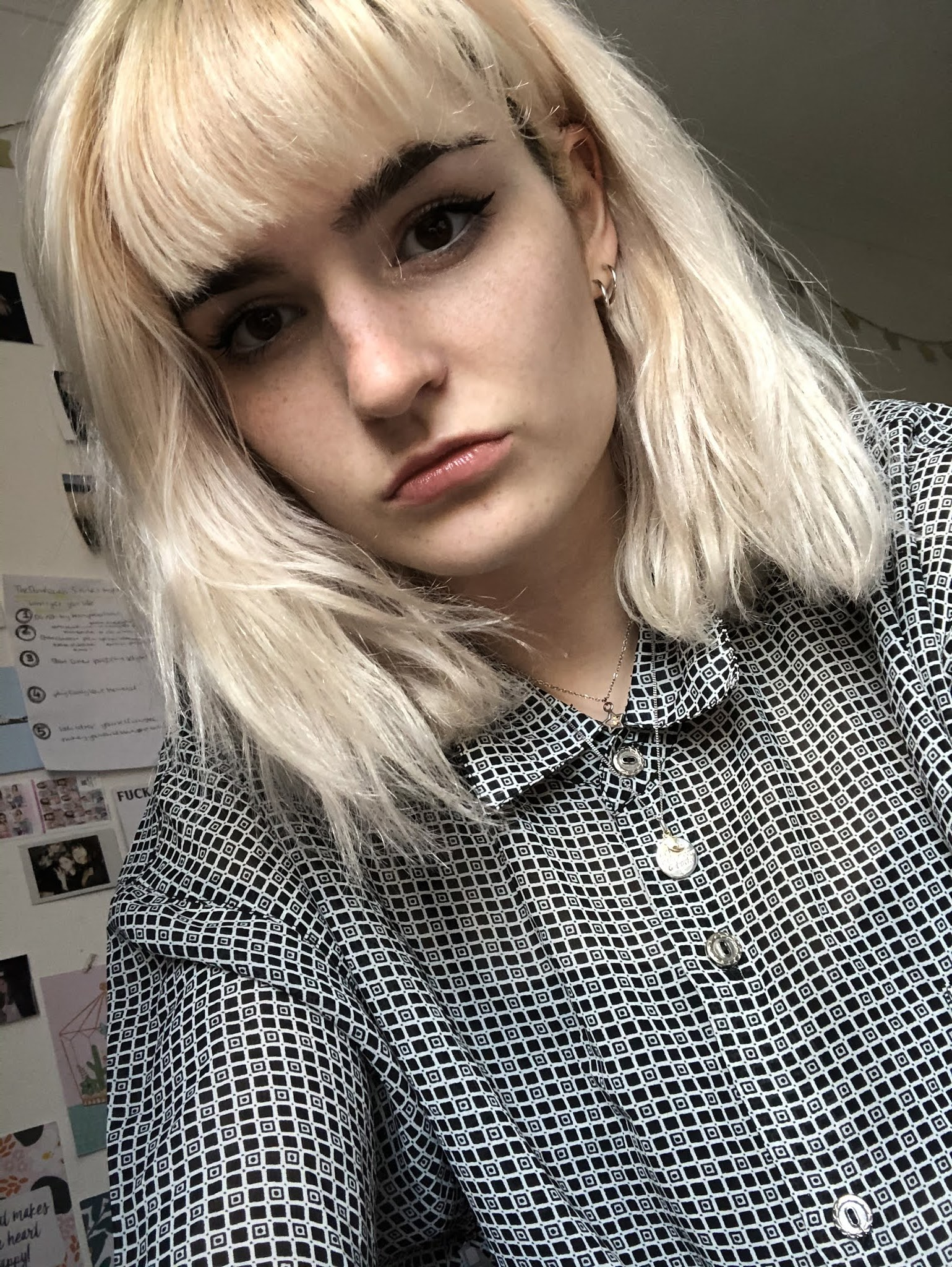 Girl with bleached blonde hair and a vintage shirt