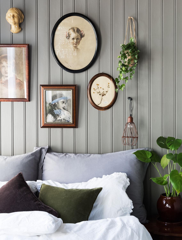 charming rustic scandinavian apartment, wood paneling, white floor, art, bedroom