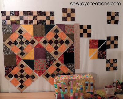 pumpkin blocks with setting triangles as quilt top