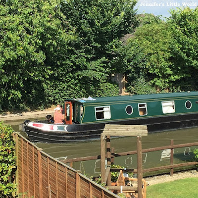 Canal boat at the bottom of the garden