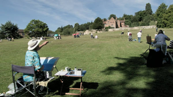 Wildcard artists on the grass slope below the house at Chartwell